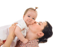 mother kissing her baby girl Isolated on white bac Royalty Free Stock Photography