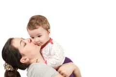 mother hugging her baby girl in arms Isolated on w Royalty Free Stock Photography