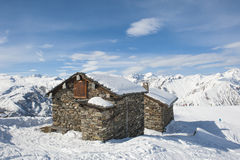 Isolated mountain hut in the snow Stock Image