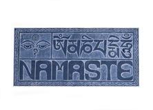 Isolated namaste sign on stone. With white background Royalty Free Stock Photo
