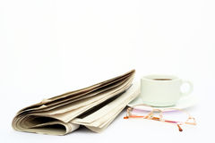 Isolated news paper, glasses and coffee