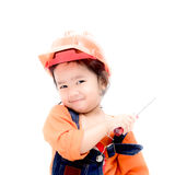 Isolated ngineer baby girl and screw driver in hand Royalty Free Stock Image