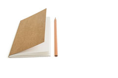 Isolated a notebook with brown paper cover and a brown pencil on Royalty Free Stock Image
