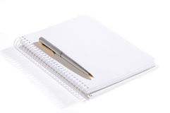 Isolated notebook with pen. Isolated open notebok with metal pen on a white background Stock Photo