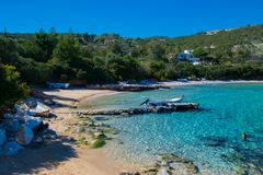 Isolated nudist beach in Ramnounda, located 65 kilometers from the center of Athens in Greece. Greek beach with crystal blue waters in Greece Royalty Free Stock Photography