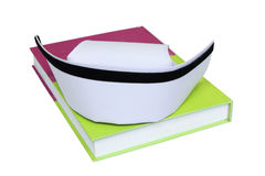 An isolated nurse hat on textbook. Nurse hat on textbook.photo isolated on white background royalty free stock photography