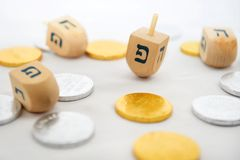 Isolated Obejects for Hanukkah. Photo of dreidels (spinning tops) and gelts (candy coins) for Hanukkah isolated on white Stock Photo