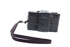 Isolated old black camera with belt Royalty Free Stock Image