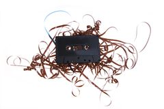 Isolated old broken compact cassette Royalty Free Stock Photo
