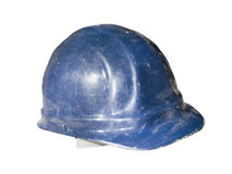 Isolated old hard hat. An old used blue hard hat with scratches and obvious wear. Isolated on white with clipping path Stock Photography