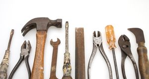 Isolated Old Tool Set. Old Tool set hammer pliers driver wrench chisel royalty free stock images