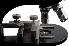 Isolated old type microscope in laboratory. Isolated black old type microscope in microbiology laboratory Stock Photo