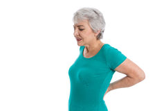 Isolated older woman with backache. Isolated older woman in green shirt with backache Stock Image