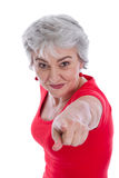 Isolated older woman is pointing with her finger. Stock Image