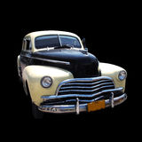 Isolated oldtimer. Detail of classic american car isolated on black Stock Image