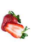 Isolated one and half Strawberries Royalty Free Stock Photos