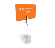 Isolated orange card in a stand. Orange card with copy space for contact info in a stand Stock Images