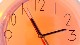 Isolated orange clock. close up, hours day. Isolated orange clock. close up of an office clock on white background with clipping path stock video footage