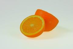 Isolated Orange half. Orange sliced in half ready to eat Stock Photo