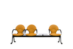 Isolated orange modern seats on white Royalty Free Stock Image