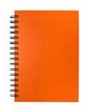 Isolated orange notebook Stock Photography
