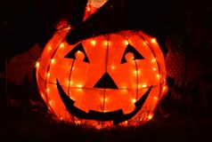 Isolated Orange Pumpkin Glowing Bright at Night Halloween stock images