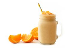 Isolated orange smoothie in mason jar with fruit slices Royalty Free Stock Photos