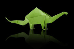 Isolated origami paper green dinosaur brontosaurus. Isolated origami paper green brontosaurus dinosaur on black background Royalty Free Stock Images