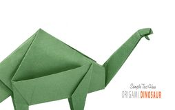 Isolated origami paper green dinosaur brontosaurus. Isolated origami paper green brontosaurus dinosaur on black background Stock Photos
