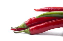 Isolated pack of top chili peppers. Isolated pack of top red and green chili peppers Stock Photography