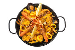 Isolated paella. Spanish tradicional paella home-made composed of rice, and  fresh seafood like clams, king prawns and squid rings. Isolated Paella Royalty Free Stock Image