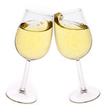 Isolated pair of champagne flutes making a toast Royalty Free Stock Images