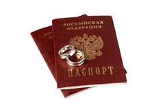 Isolated pair of wedding rings and passports Royalty Free Stock Image