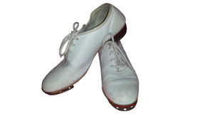 Isolated pair of worn clogging shoes for tap dance or clog dance. Stock Photography