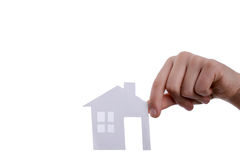 Isolated paper house in hand. Hand holding an isolated paper house with a white background Stock Photos