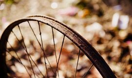 Isolated parts of a metallic bicycle wheel ring stock image