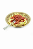 Isolated pasta with fork Stock Images