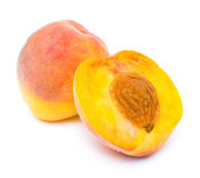 Isolated peach and its half Royalty Free Stock Image