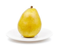 Isolated pear on the plate Royalty Free Stock Image