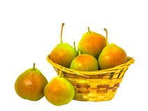 Isolated pears are in the basket. Pears are in the basket. Two pears lie nearby. Composition on a white background Stock Photography