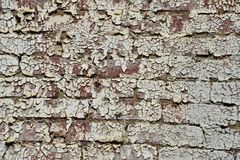 Isolated peeling paint on brick wall on side of vintage building. Peeling paint of brick wall on side of old building royalty free stock image