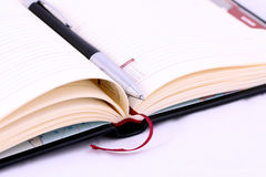 Isolated pen on the notebook, diary Royalty Free Stock Image