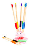 An isolated pencil holder with colorful pencils Royalty Free Stock Images