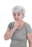 Isolated pensive older woman search a solution. Isolated pensive older woman search a solution holding her finger bevore her mouth Stock Image