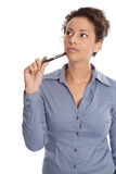Isolated pensive and reflective business woman looking up sideways. royalty free stock photo