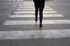 Isolated person on the crosswalk. In the city stock photos