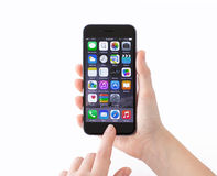Isolated phone iPhone 6 Space Gray in a woman hands Royalty Free Stock Image
