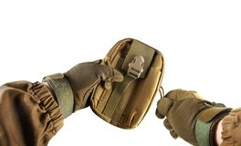 Soldier arms holding military tactical pouch