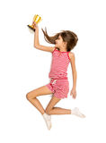 Isolated photo of happy girl running with golden trophy cup Royalty Free Stock Images