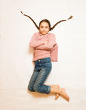 Isolated photo of sad girl with long braids lying on floor Stock Photo
